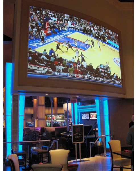 Inside the O.h. lounge, this projection onto a curved surface is typically used for sports odds viewing.