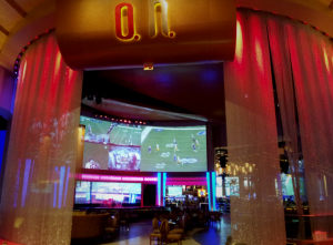 The O.H. Lounge incorporates a huge 74 by 19 foot Christie Digital projected video wall, an LED video wall consisting of 18 55-inch Planar LED displays, a line-array audio system from EAW, and stage Lighting from ETC and Varilite.
