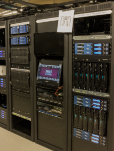 Television encoding racks, server racks, and distribution shown during the assembly of the system.