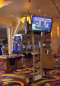 "Four-sided ""Tree"" displays sports to tables-games players on the casino floor."