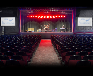This state of the art audio system is comprised of all Martin Audio speaker components. The left and right speaker arrays each consist of 7 Martin MLA compact modules. Mounted under the stage are 6 DSX sub-woofers as well as 4 DD6 front fills. Two WT3 out fills provide coverage for the rear of the room.