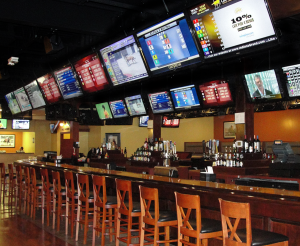 The 50 seat bar area is surrounded by 46 network connected LED Smart TV's controlled via a WiFi tablet running Control Point's audio video automation software.