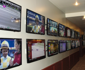 Over 40 individual handicapping stations share this room with 32 LED Smart TV's. Each room of the facility is configured for an independent overhead audio source and volume controllable via a WiFi Tablet.