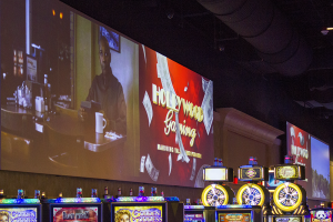 "Another large projection ""Billboard"" on the Casino floor. The video feed to each projector is easily changed via Control-Point's automation software running on wireless tablet PC's."