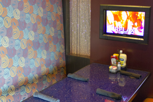Each Skybox Sports Bar booth features a guest controlled TV.