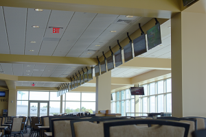 Upper Level Simulcast area and grandstand. Simulcast and live racing feeds are managed on the 131 network controlled TV's via Control-Point's automation software. RF signal distribution is accomplished via Z-Band's video over cat-5 system.