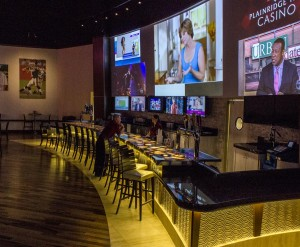 Doug Flutie's Sports Pub features a 37 foot x 9 foot projection wall. Three Christie HD10k projectors are blended to create a seamless viewing area for up to 8 unique video feeds in various user selectable layouts.